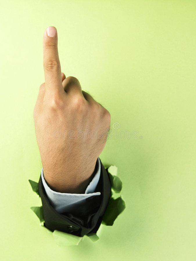 Hand breaking through paper royalty free stock images