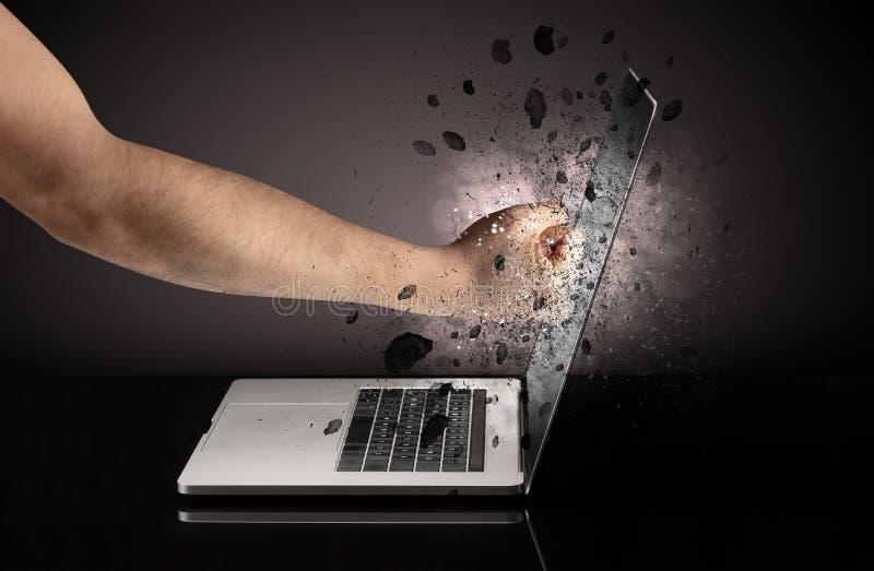 Hand breaks laptop glasses. Strong male hand breaks laptop screen glasses stock photos