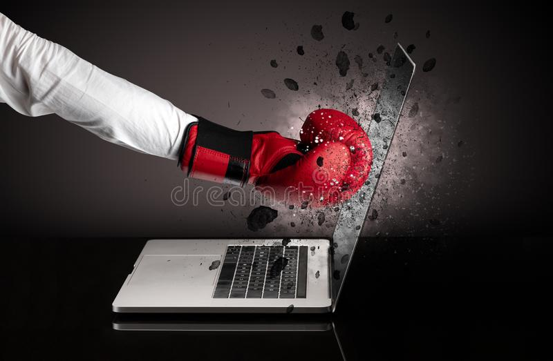 Hand breaks laptop glasses. Strong male hand breaks laptop screen glasses stock photo