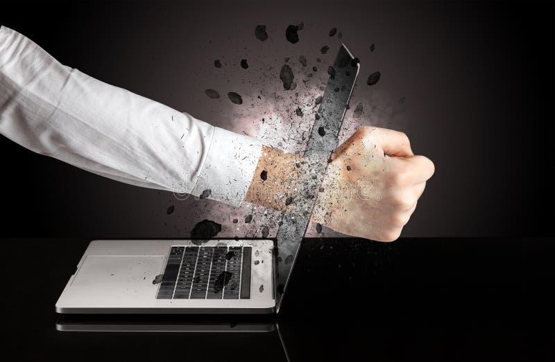 Hand breaks laptop glasses. Strong male hand breaks laptop screen glasses stock photography