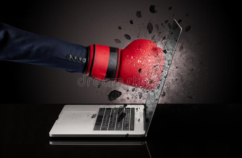 Hand breaks laptop glasses. Strong male hand breaks laptop screen glasses royalty free stock image
