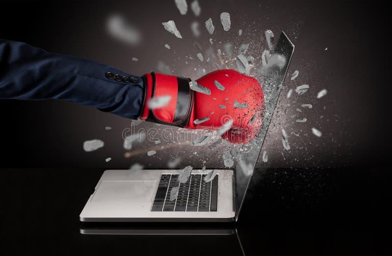 Hand breaks laptop screen. Strong male hand breaks laptop screen royalty free stock photography