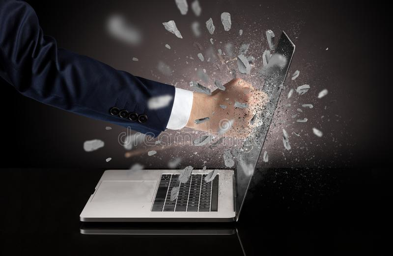 Hand breaks laptop screen. Strong male hand breaks laptop screen stock images