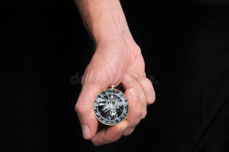 Hand and Broken Compass royalty free stock photo