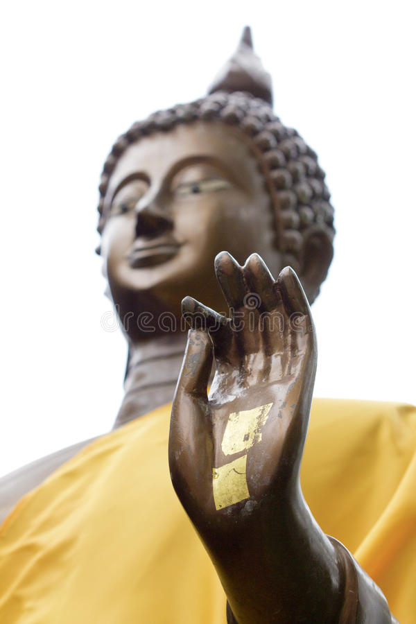 Hand of Buddha statue. With golden leaf stock images
