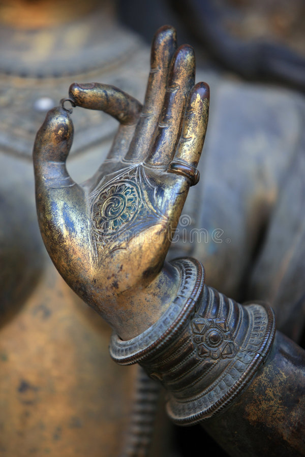Hand of buddha statue. Patan, nepal stock photos