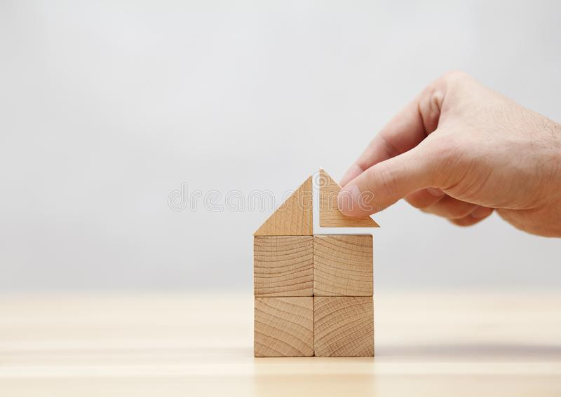 Hand building house with wooden blocks. Hand building house with small wooden blocks stock photos