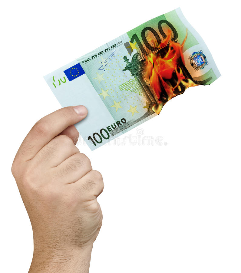 Hand Burning Flames 100 Euro Banknote Isolated. Male hand holding 100 euro banknote burning in flames isolated on white background royalty free stock images