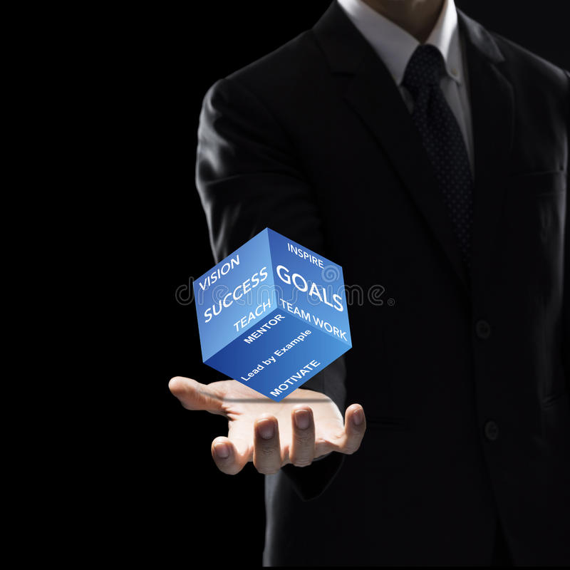 Hand of Business Man Hold box on dark background. royalty free stock images