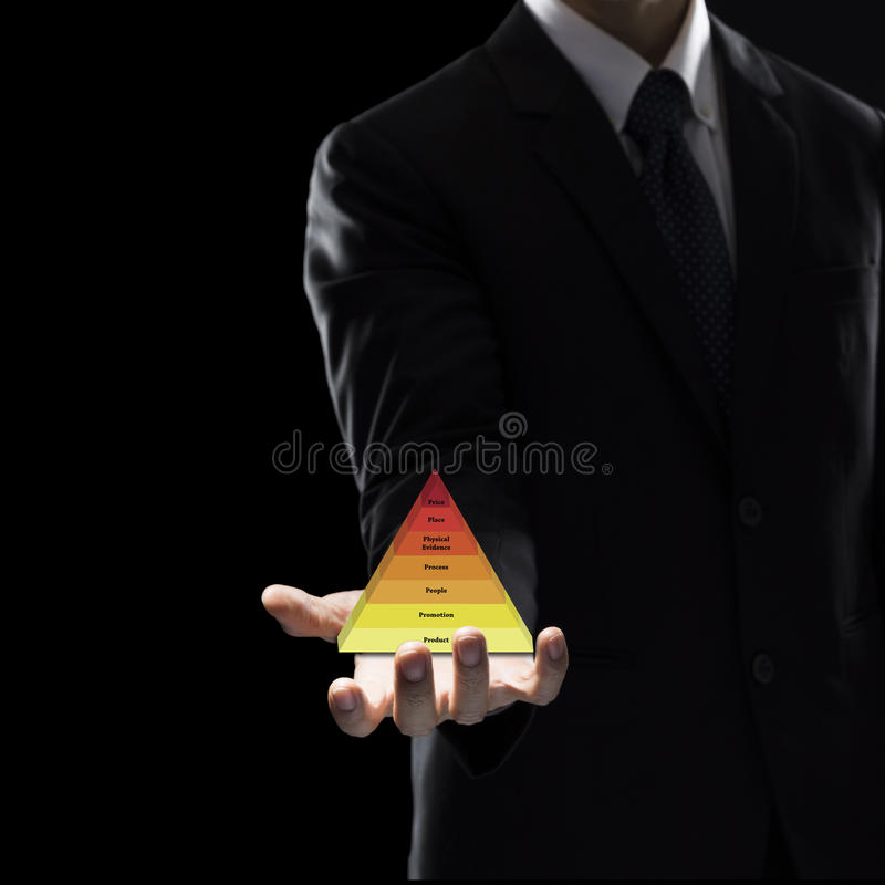 Hand of Business Man Hold triangle on dark background. stock image