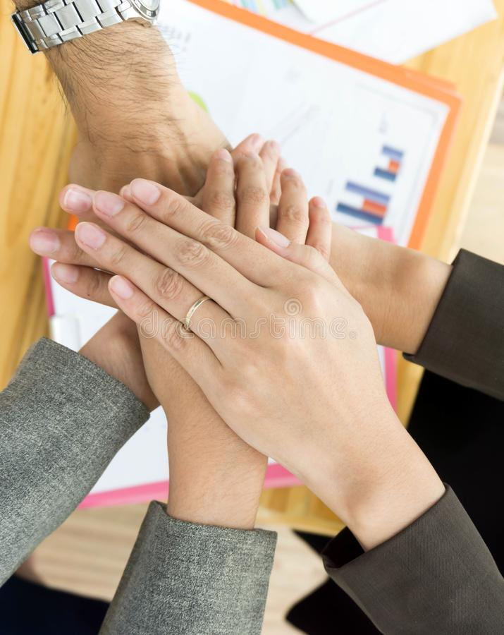 Hand of business team showing unity. royalty free stock photos