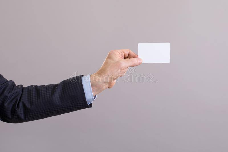 Hand of a businessman with a blank card stock photo
