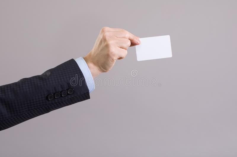 Hand of a businessman with a blank card royalty free stock photo