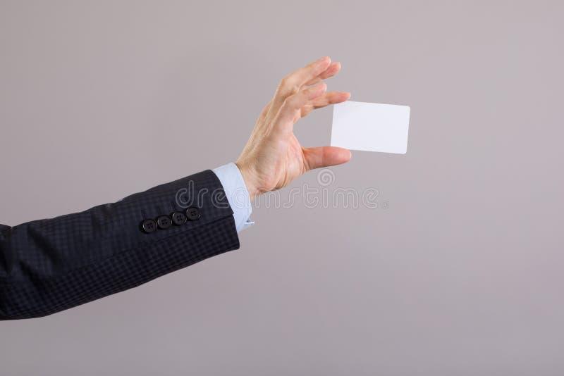 Hand of a businessman with a blank card stock photos