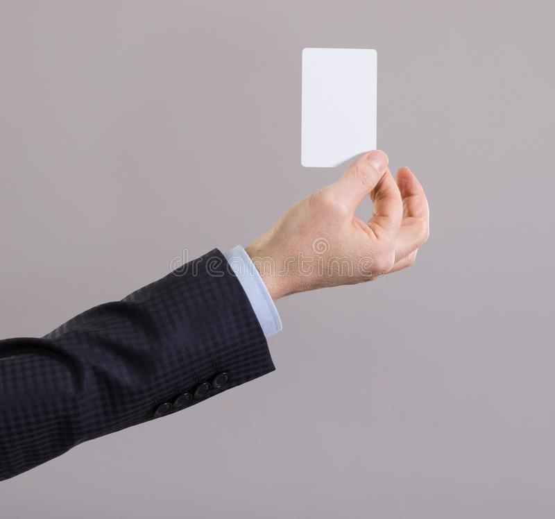 Hand of a businessman with a blank card royalty free stock photos
