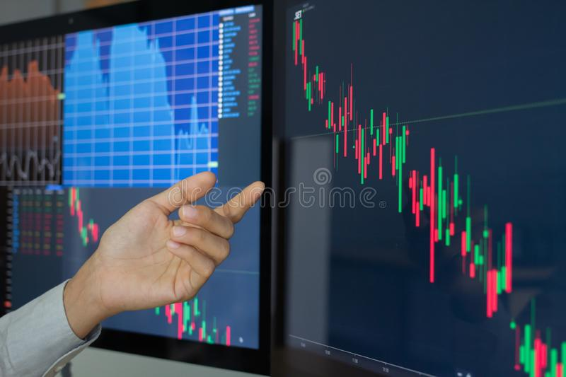 Hand of businessman group pointing and look directions change Average line Share price movement Stock trading in the up and down. stock photo