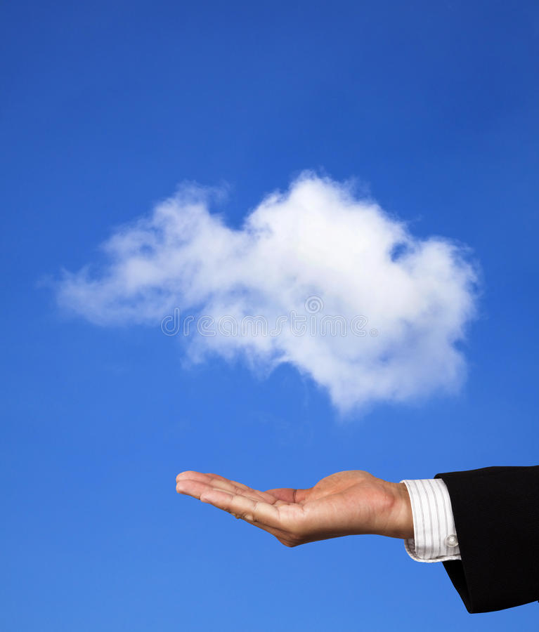 Technology Management Image: Hand Of Businessman Hold A Cloud Stock Photo