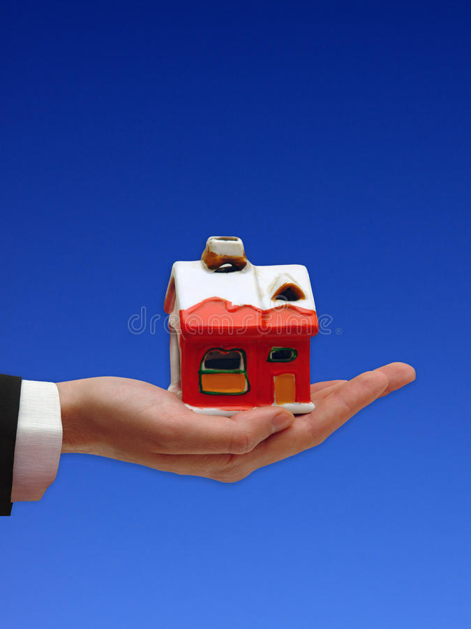 The Hand of the Businessman with the House stock photo