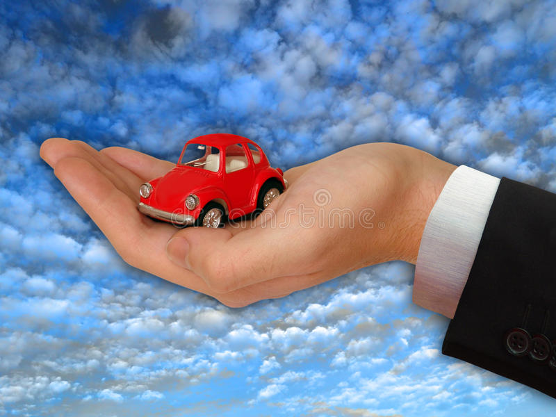 Hand of the businessman with the lovely red car. Hand of the businessman with the red car stock photos