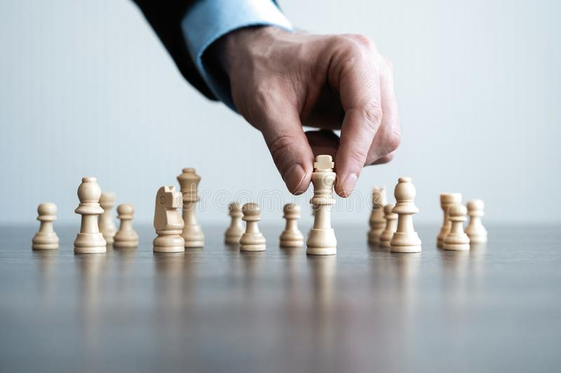 Hand of businessman moving chess figure in competition success play. strategy, management or leadership concept. stock image