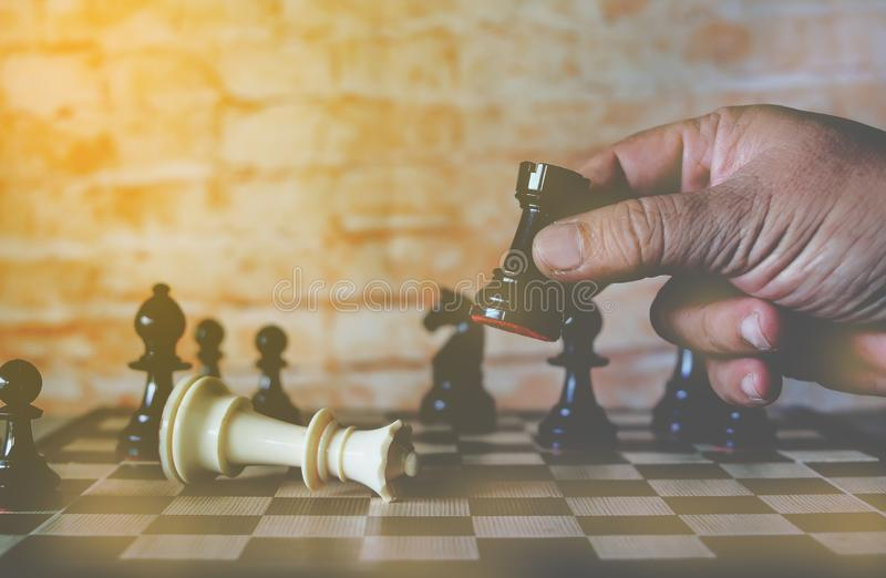 Hand of businessman moving chess figure to win competition play. ,business strategy success concept royalty free stock photography