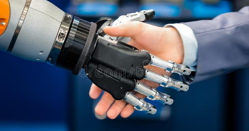 Hand of a businessman shaking hands with a droid robot. The concept of human interaction with artificial intelligence. stock images