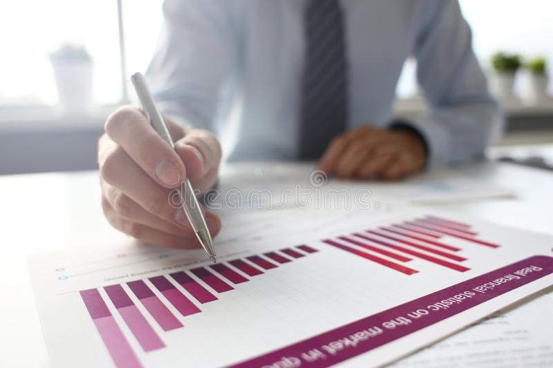 Hand of businessman in suit filling and signing with royalty free stock images