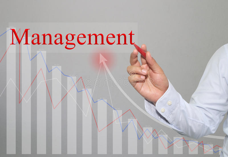 Hand of businessman Write a text of management. royalty free stock images