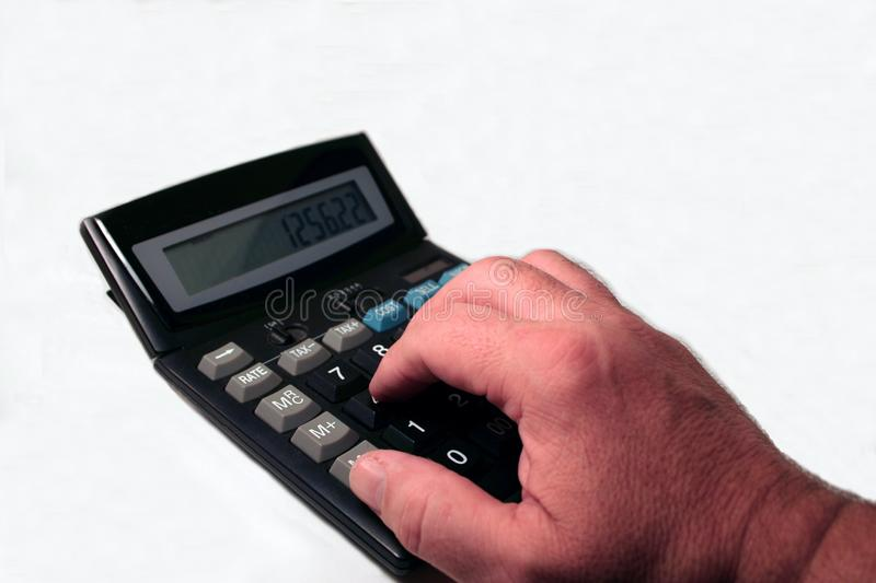 Hand at the Calculator stock photo