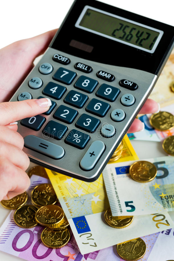 Hand with calculator and money royalty free stock image