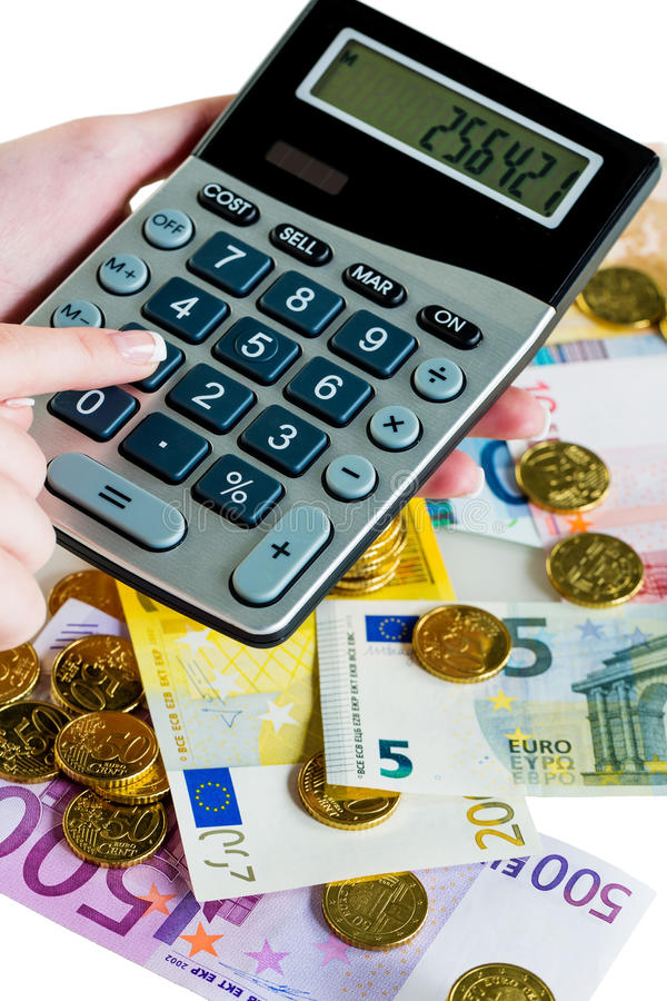 Hand with calculator and money royalty free stock photography