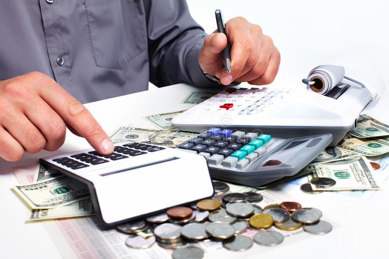 Hand with calculator and money. stock photo