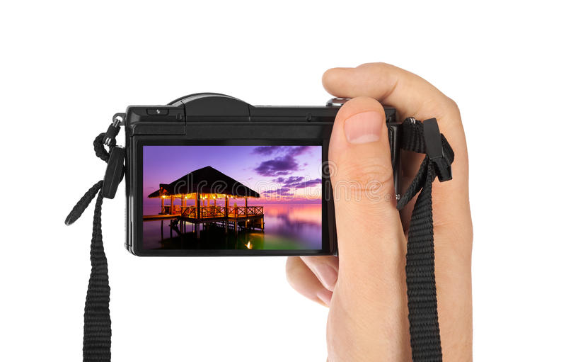 Hand with camera and Maldives beach photo (my photo). Isolated on white background royalty free stock images