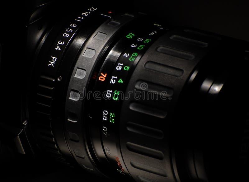 Hand cameralens stock afbeelding