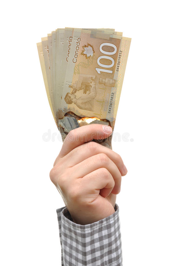 Hand and canadian dollar. Hand and new canadian one hundred dollar stock photo