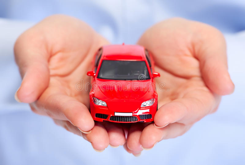 Hand with car. Auto dealership and rental concept background royalty free stock photography