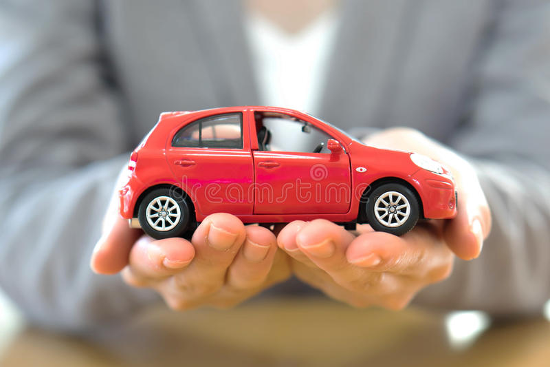 A Hand with car. Auto dealership and rental concept background. stock photo