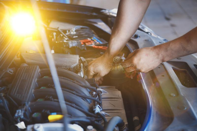 Hand of car mechanic with wrench. Auto repair garage. stock photos