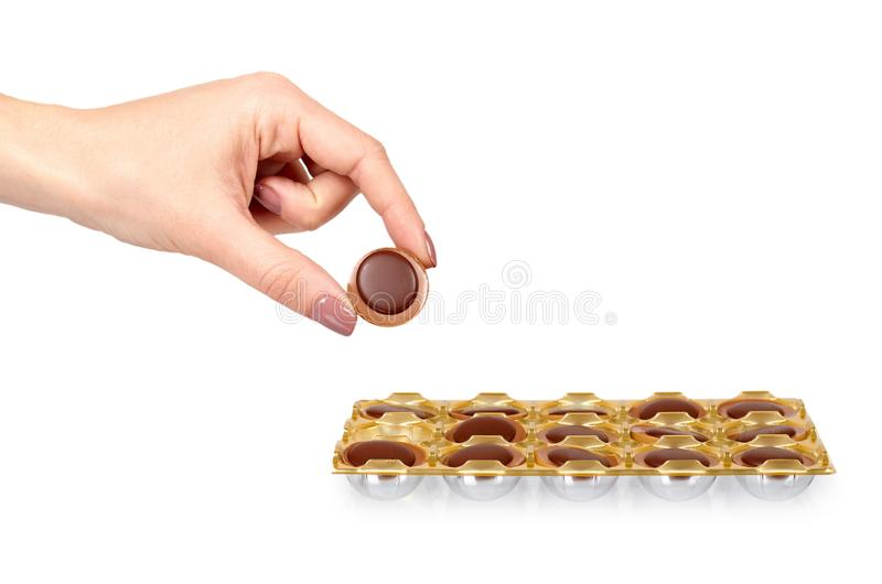 Hand with caramel candies, sweet dessert, unhealthy food. Isolated on white background toffee candy brown confectionery tasty sugar treat yummy culinary stock photo