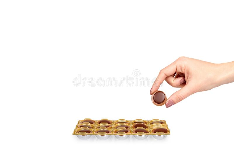 Hand with caramel candies, sweet dessert, unhealthy food. Isolated on white background. Copy space template, toffee, candy, brown, confectionery, tasty, sugar stock images