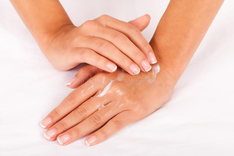 Hand care. Take care of your hands with pleasure (on a white cotton textile stock images