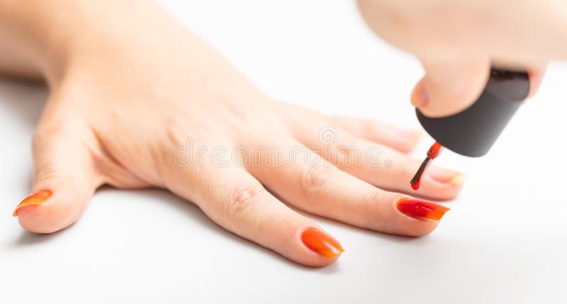 Nail painting with red lacquer royalty free stock photos