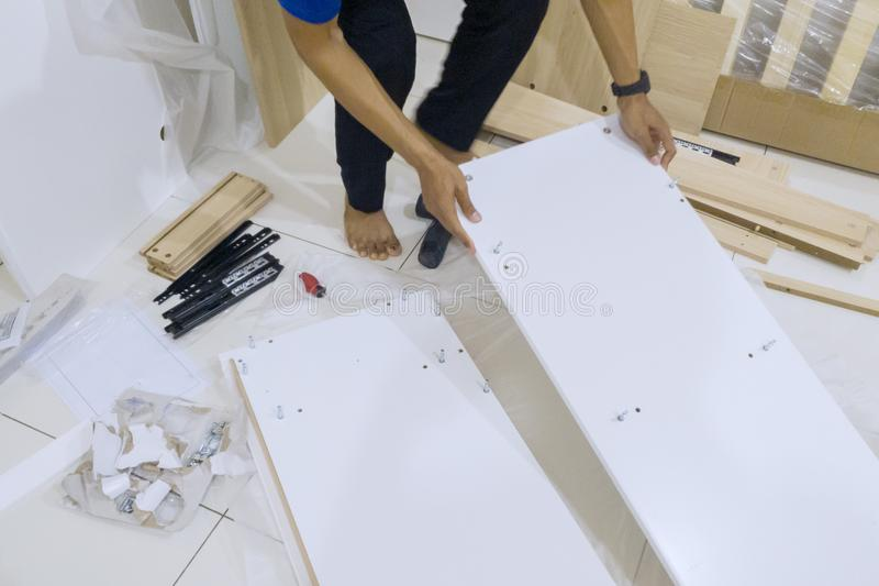 Hand of carpenter assembling parts of furniture royalty free stock images
