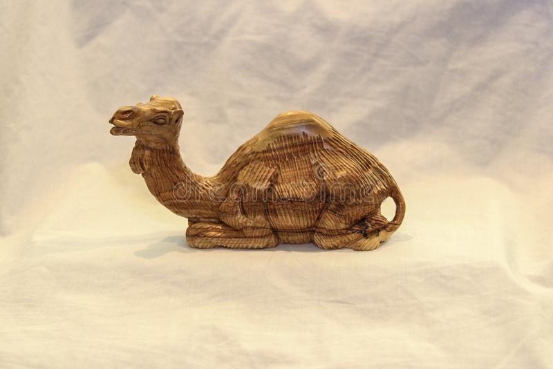 Hand carved olive wood camel stock photos