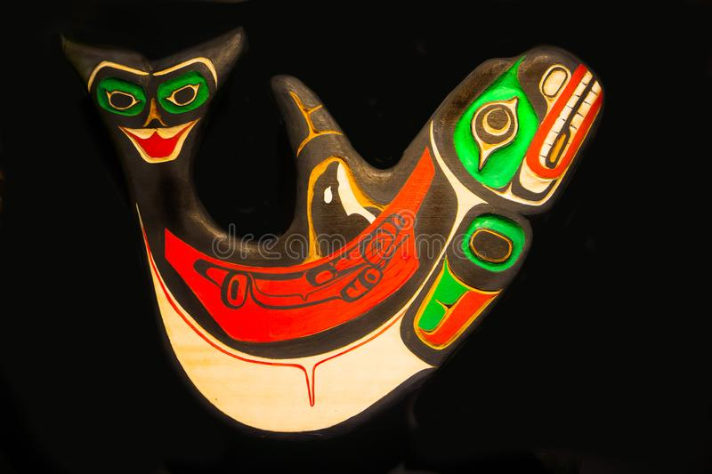 Alaskan Carved Art Orca Whale Black Background royalty free stock photography