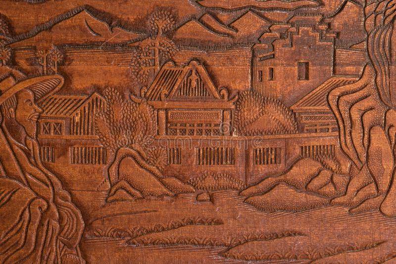 Hand carved in wood. From an oriental scene stock photo