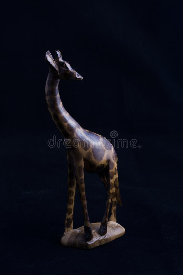Hand carved wooden giraffe royalty free stock images