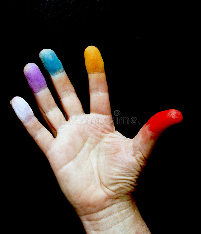 Hand Chakras. On a black background royalty free stock image