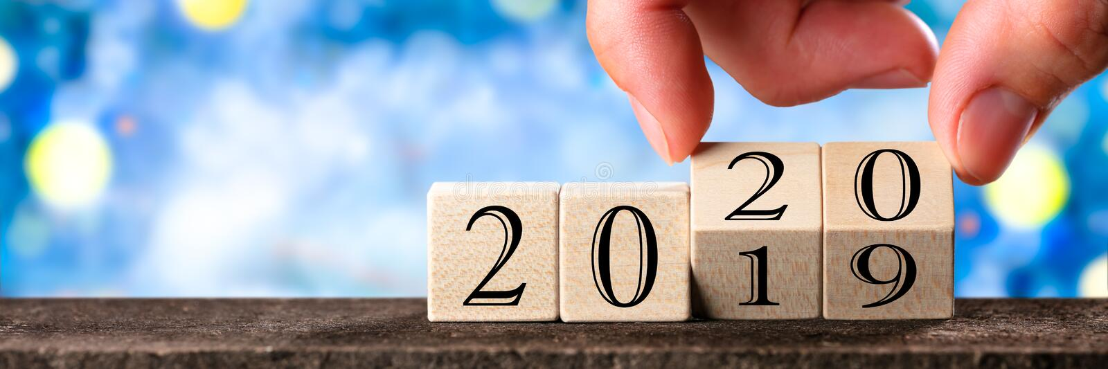 Hand Changing Date From 2019 To 2020 royalty free stock images