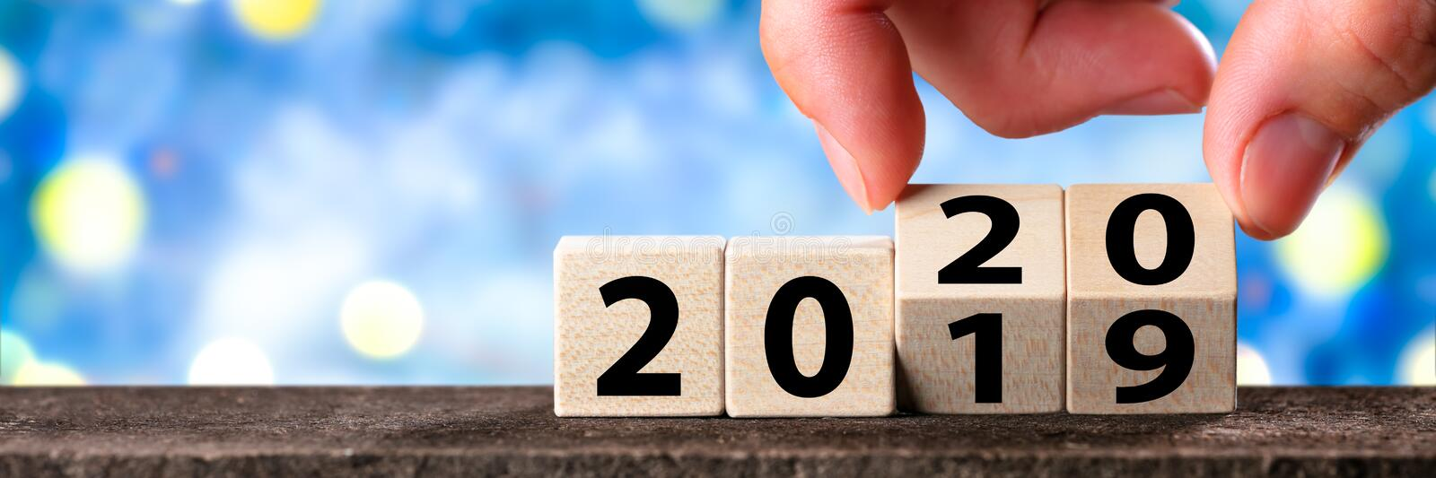 Hand Changing Date From 2019 To 2020 stock images